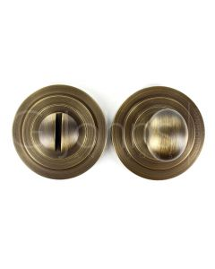 bathroom-oval-knob-turn-release-with-stepped-round-rose-53mm-x-10mm-antique-brass-pair